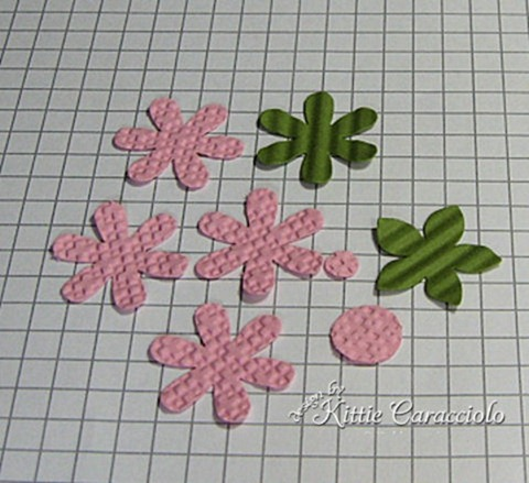 Punched flower tutorial kittiekraft punch out pink and green flowers and circles i embossed the pink and crimped the green to add texture mightylinksfo